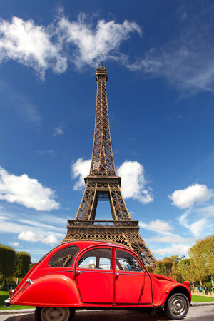 Eiffel Tower with old retro car in Paris, France\