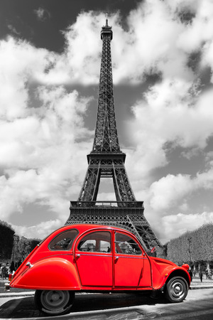 Eiffel Tower with old retro car in Paris, France