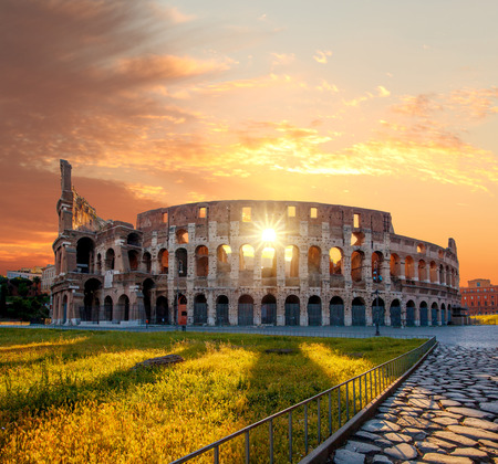 Colosseum against colorful sunset in Rome, Italy photo