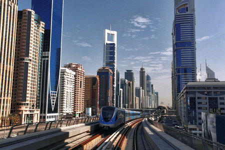 tall buildings: Dubai with  Metro and skyscrapers in United Arab Emirates