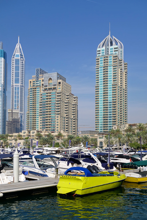 Dubai Marina with boat against skyscrapers in Dubai, United Arab Emirates