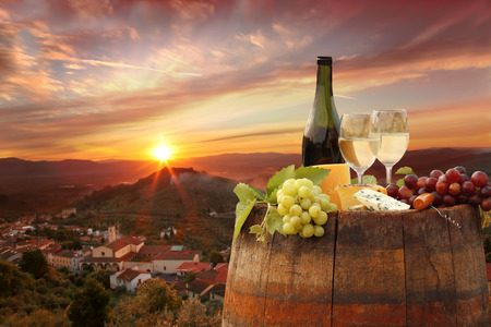 chianti: White wine with barrel against sunset in Chianti, Tuscany, Italy Stock Photo