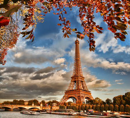 Eiffel Tower with boat on Seine in Paris, France photo