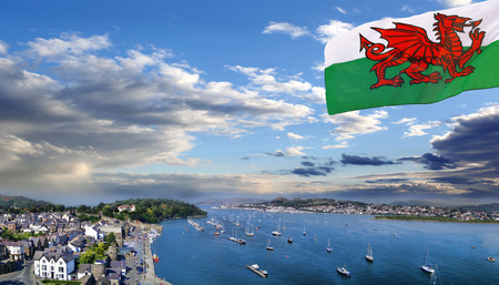 king edward: Conwy town with flag of Wales, United Kingdom