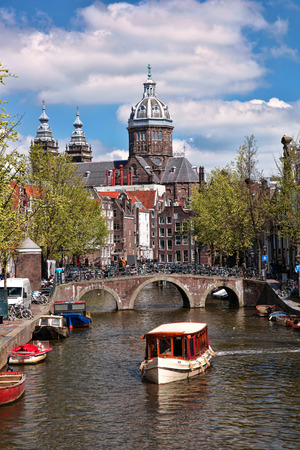 holland landscape: Amsterdam city with boats on canal in Holland