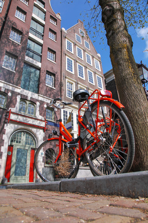 Amsterdam with bicycle  against houses, Holland photo