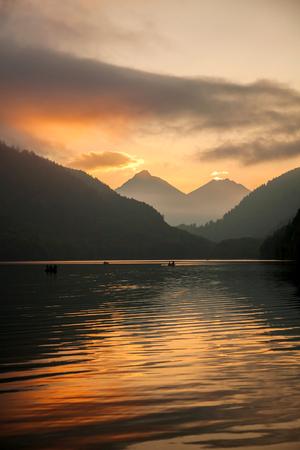 schwangau: Schwangau lake in Bavaria Alps against sunset, Germany