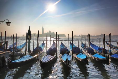 Gondolas against sunset in Venice, Italy photo