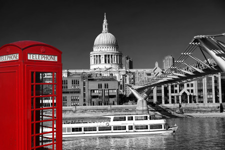 Red telephone box against St.Paul cathedral  in London, UK photo