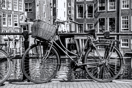 Amsterdam in black and white style with bicycle on the bridge in Holland photo