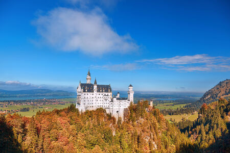 Famous Neuschwanstein castle with autumn forest in Bavaria, Germany