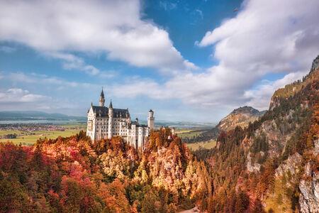 neuschwanstein: Famous Neuschwanstein castle with autumn forest in Bavaria, Germany
