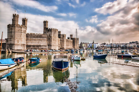 south west england: Caernarfon Castle in Wales, United Kingdom, series of Walesh castles