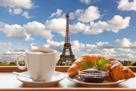 Coffee with croissants against Eiffel Tower in Paris, France photo