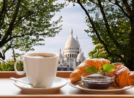 coeur: Paris cafe with croissants against Sacre Coeur basilica in France