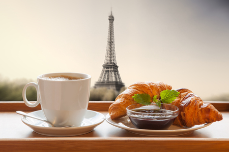 croissant: Coffee with croissants against Eiffel Tower in Paris, France