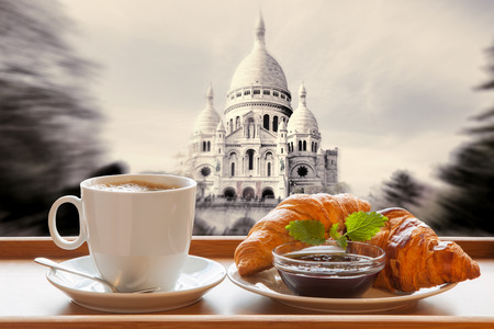 Paris cafe with croissants against Sacre Coeur basilica in France photo