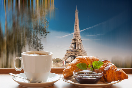 roll bar: Coffee with croissants against Eiffel Tower in Paris, France