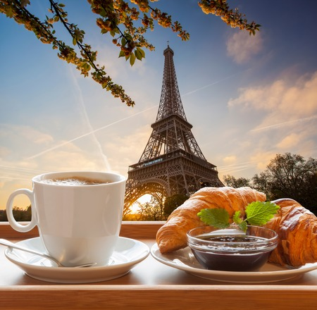 Coffee and croissants against Eiffel Tower in Paris, France photo