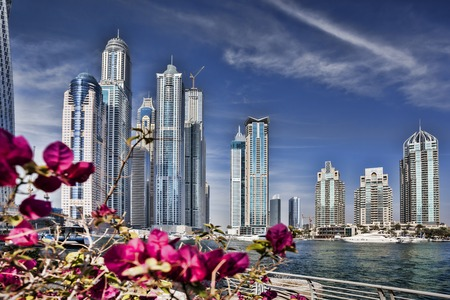 Dubai Marina with skyscrapers and boats in Dubai, United Arab Emirates photo