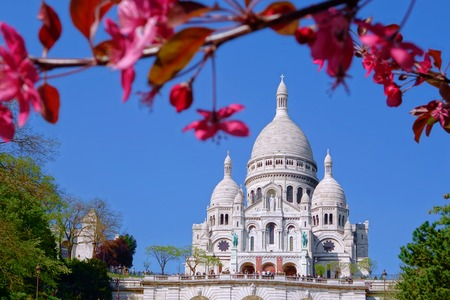 copule: Famous Sacre Coeur Cathedral during spring time in Paris, France