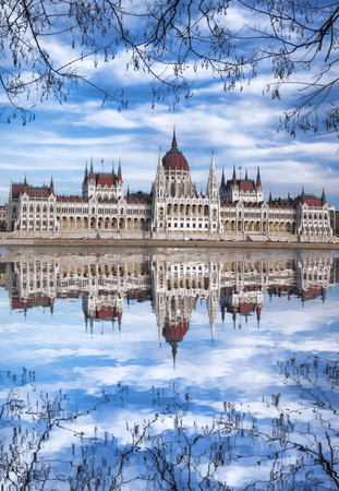 budapest: Famous Parliament with river in Budapest, Hungary Stock Photo