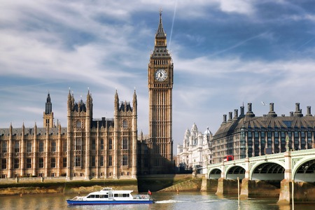 Famous Big Ben with bridge in London, England photo