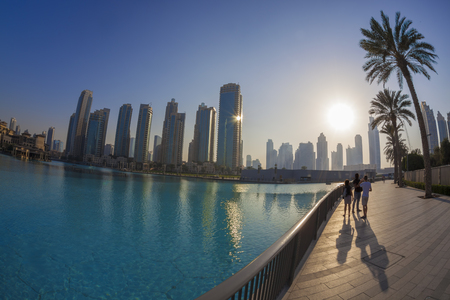 mid morning: Dubai lagoon with skyscrapers against sunset in United Arab Emirates Stock Photo