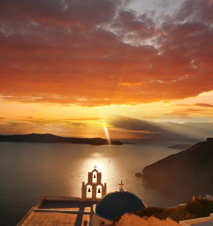 caldera: Sunset  over sea in Santorini island, Greece Stock Photo