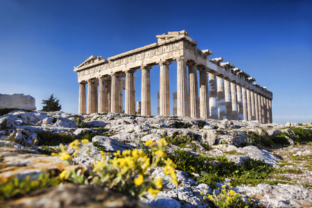 classical greece: Parthenon temple with spring flowers on the  Acropolis in Athens, Greece Stock Photo