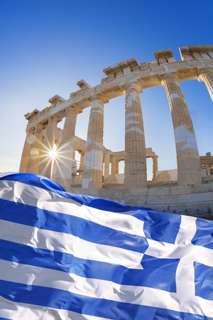 greece flag: Parthenon temple with Greek flag  on the Athenian Acropolis, Greece Stock Photo
