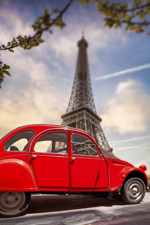 Famous Eiffel Tower with old red car in Paris, France photo