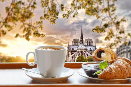 Notre Dame cathedral with coffee and croissants in Paris, France photo