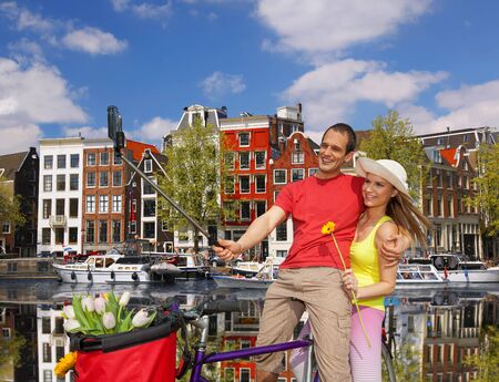 Couple Taking Selfie in  Amsterdam city, Holland photo