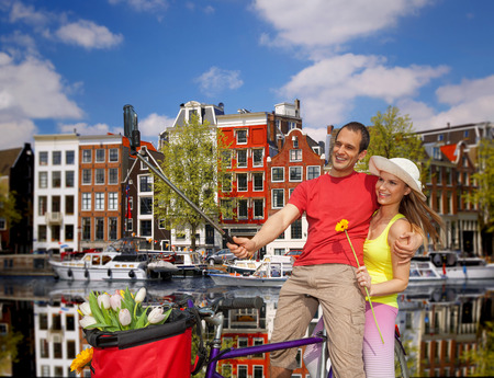 take a history: Couple Taking Selfie in  Amsterdam city, Holland