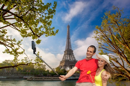 Couple Taking Selfie by famous  Eiffel Tower in Paris, France photo