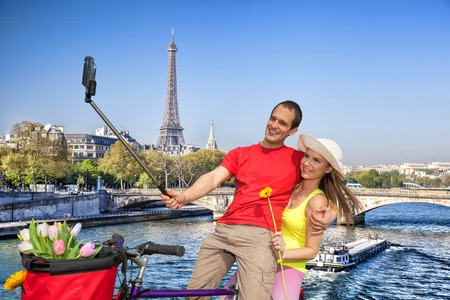 take a history: Couple Taking Selfie by famous  Eiffel Tower in Paris, France Stock Photo