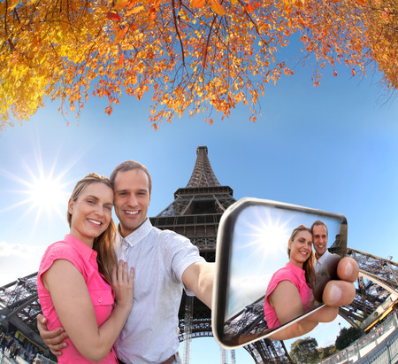 take a history: Couple Taking Selfie by famous Eiffel Tower in Paris, France