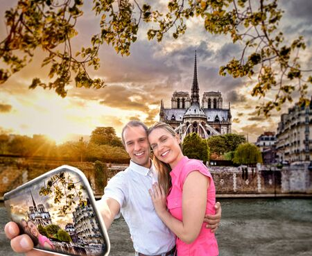 notre dame cathedral: Couple Taking Selfie by famous Notre Dame cathedral in Paris, France