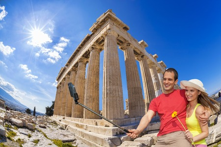 take a history: Couple taking selfie against Parthenon temple on the Acropolis in Athens Greece Stock Photo
