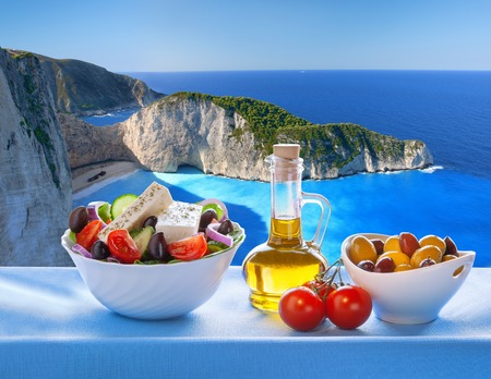 Famous Navagio beach with Greek salad in Zakynthos Greece