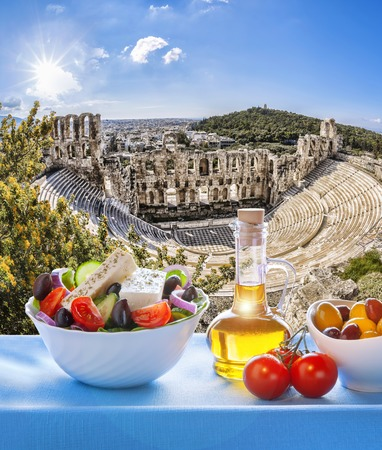 Greek salad with Acropolis in Athens Greece photo