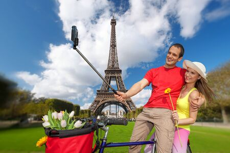 take a history: Couple Taking Selfie the Eiffel Tower in Paris France