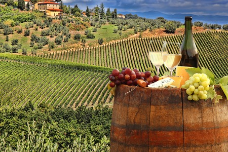 tuscany: White wine with barrel on famous vineyard in Chianti Tuscany Italy