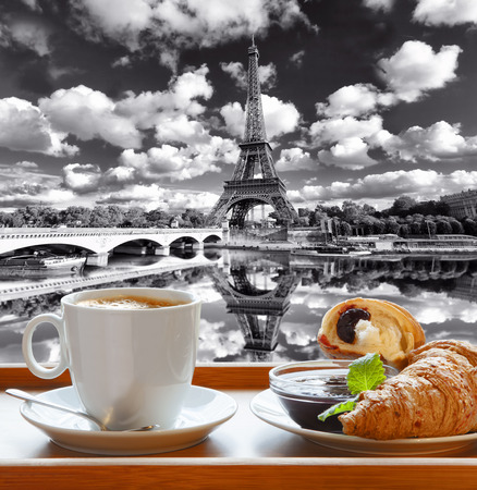 l plate: Coffee with croissants against famous Eiffel Tower in Paris France