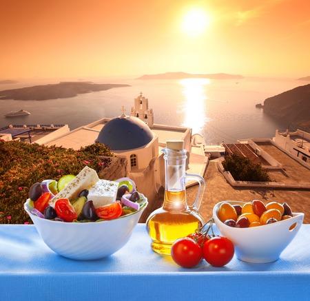 firostefani: Santorini greek salad with Firostefani Church against Greece in Fira Stock Photo