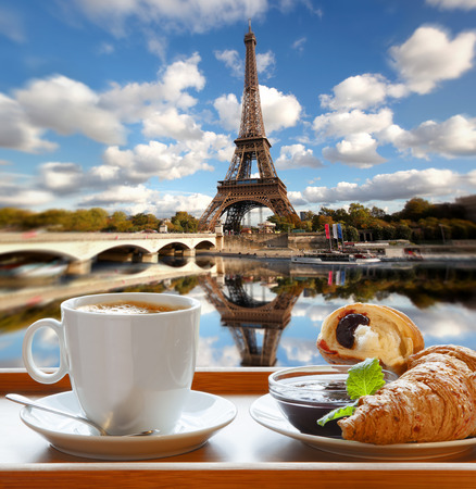 france: Coffee with croissants against famous Eiffel Tower in Paris France
