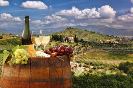 italy landscape: White wine with barrel on famous vineyard in Chianti Tuscany Italy