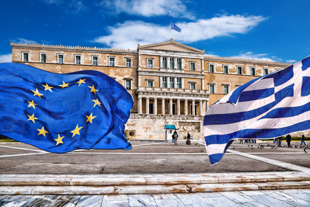 greek columns: Greek parliament with flag of Greece and flag of the European Union in Athens, Greece Stock Photo