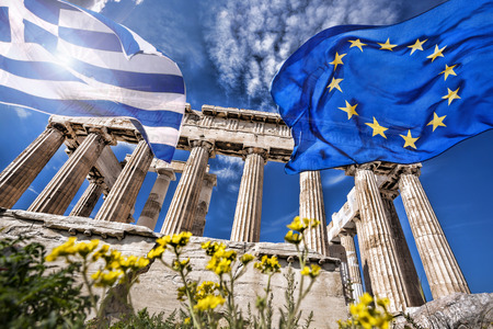 greece flag: Acropolis with flag of Greece and flag of the European Union in Athens, Greece
